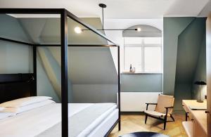 Een stapelbed of stapelbedden in een kamer bij Nobis Hotel Copenhagen, a Member of Design Hotels™