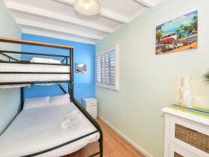 A bunk bed or bunk beds in a room at Gone To The Beach House