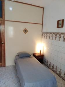 Кровать или кровати в номере Edificio Magico