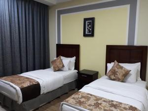 Cama ou camas em um quarto em Benzart Hotel Apartments