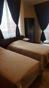 Кровать или кровати в номере Guest House Chinar 08
