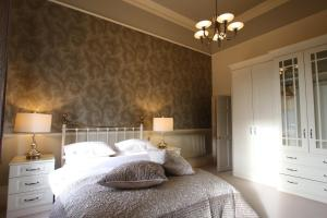 A bed or beds in a room at The Dower House Apartments