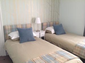 Een bed of bedden in een kamer bij Brewery House Bed & Breakfast