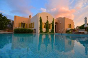 The swimming pool at or near Pleiades Eco Houses