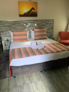 A bed or beds in a room at Ecolux Boutique Hotel