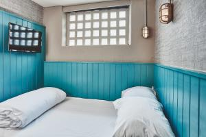 A bed or beds in a room at The Garrison