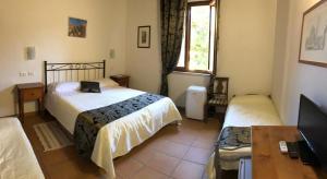 Cama ou camas em um quarto em Villa Tuscany Siena