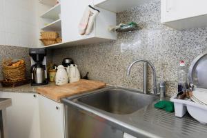 A kitchen or kitchenette at Motel D'ornex