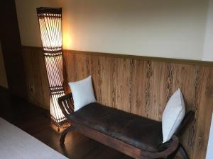 A bed or beds in a room at Tanakaya Ryokan