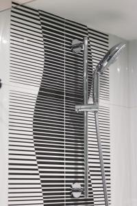 Ванная комната в Signature Lux Hotel by ONOMO, Waterfront