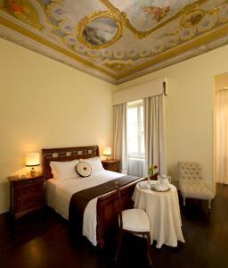 Ein Bett oder Betten in einem Zimmer der Unterkunft 1865 Residenza D'Epoca