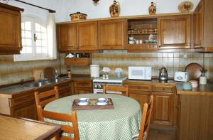 A kitchen or kitchenette at Athena Cretan Traditional Maisonette