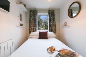 A bed or beds in a room at Cosy Woodland Home