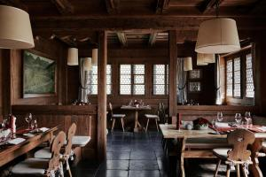 A restaurant or other place to eat at The Alpina Gstaad