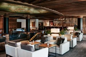 The lounge or bar area at The Alpina Gstaad