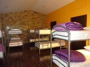 A bunk bed or bunk beds in a room at O Cabanel