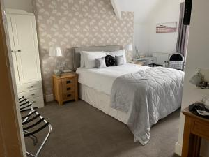 A bed or beds in a room at Abbey House