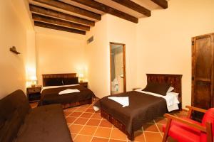 A bed or beds in a room at Hotel Casa Moreno La Vega
