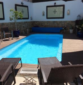 The swimming pool at or near Luxury Guest House_Opus One