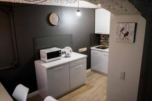 A kitchen or kitchenette at LvivSon Apartments