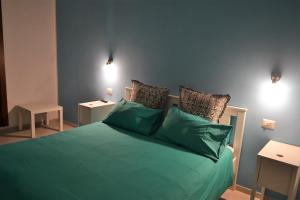 A bed or beds in a room at Villa Arechi