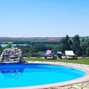 The swimming pool at or near Hacienda el Santiscal