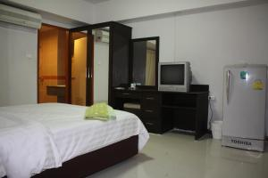 A bed or beds in a room at Tamarind Residences