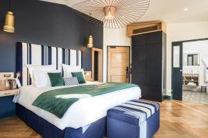 A bed or beds in a room at Hôtel & Spa Madison Saint Jean de Luz