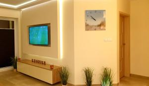 A television and/or entertainment centre at Apartment Sunrise