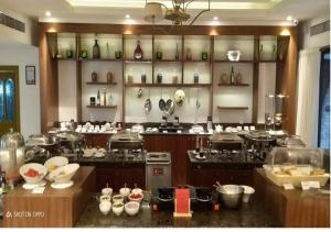 """A restaurant or other place to eat at Fragrant Nature Kochi - """"A Classified Five Star Hotel"""""""