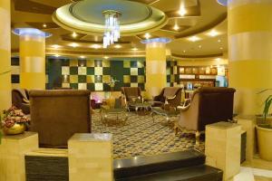 Um restaurante ou outro lugar para comer em Sanam Hotel Suites