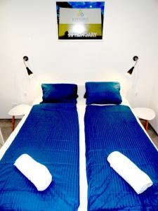 A bed or beds in a room at Trenta Apartman Bükfürdő