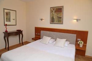 Кровать или кровати в номере Hotel Park Central