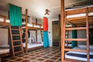 A bunk bed or bunk beds in a room at Casa Kayam Hostal y Residencia Artística