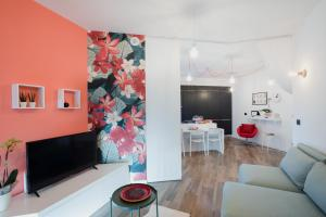 A television and/or entertainment center at B&B LeTerrazze Boutique Hotel - Torino