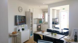 A kitchen or kitchenette at Rooftop Terrace Apartment for Large Groups