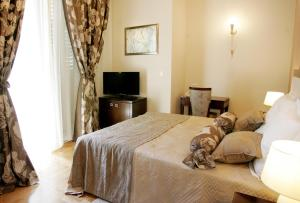 A bed or beds in a room at Palace Augubio