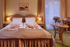 Hotel Polaris IIIにあるベッド
