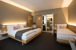 A bed or beds in a room at Best Western Plus Hotel Zürcherhof