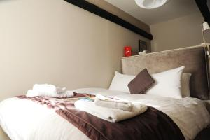 A bed or beds in a room at The Red Lion Hotel