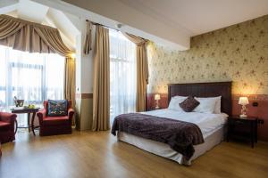 A bed or beds in a room at Premier Luxury Mountain Resort
