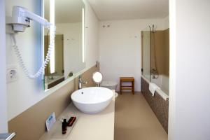 A bathroom at Convento Da Serta Hotel