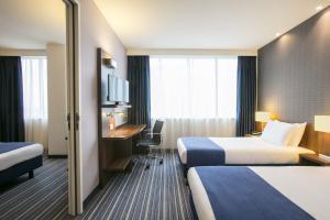 מיטה או מיטות בחדר ב-Holiday Inn Express Amsterdam - South, an IHG Hotel