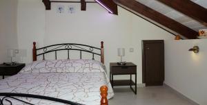 Ένα ή περισσότερα κρεβάτια σε δωμάτιο στο Fegaropetra studios