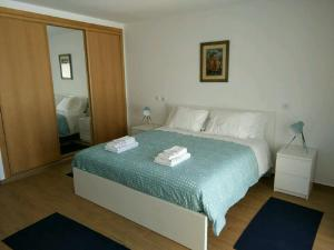 A bed or beds in a room at Ribalta Beach Houses