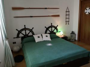 A bed or beds in a room at B&B Villa Ines
