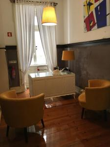 A kitchen or kitchenette at Hotel Jardim
