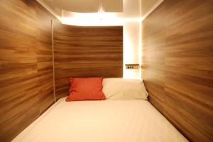A bed or beds in a room at First Cube Yamaguchi
