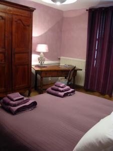 Un ou plusieurs lits dans un hébergement de l'établissement Chambres d'hôtes Au Coeur de Die