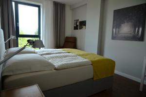 Posteľ alebo postele v izbe v ubytovaní Panoráma Bojnice
